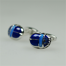This wonderfully made pair of sterling silver cufflinks feature a scarab in two shades of blue enamel. This beetle species has a background in ancient Egypt, and stands for creation and renewal. Check out the details!